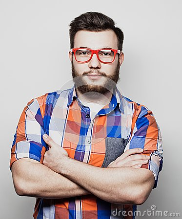 Free Lifestyle And People Concept: Young Bearded Guy Crossing His Arms Over White Background Royalty Free Stock Images - 112710069