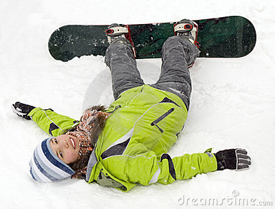 A lifestyle image of snowboarder girl