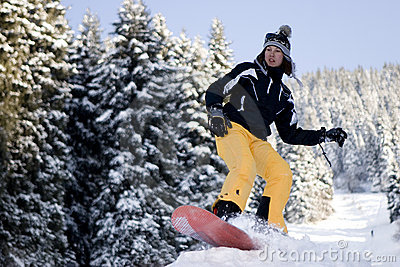 A lifestyle image of young snowboarder girl
