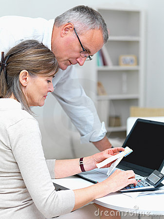 Lifestyle - Old couple doing their accounting