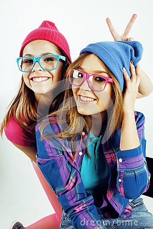 Free Lifestyle People Concept: Two Pretty Stylish Modern Hipster Teen Girl Having Fun Together, Happy Smiling Making Selfie Stock Photography - 86349282