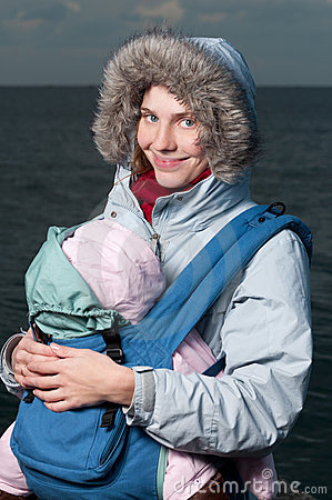 Lifestyle portrait of young mother