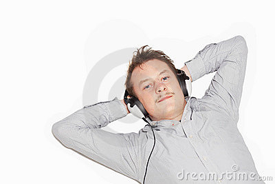 Lifestyle young man listening to music on white
