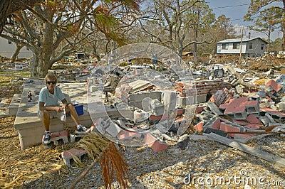 Lifetime woman resident surveying damage Editorial Stock Photo