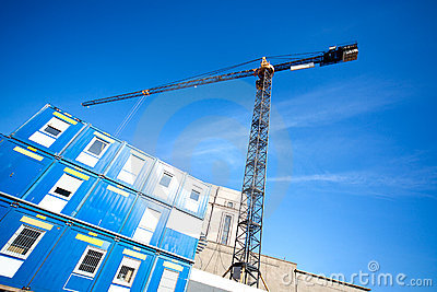 Lifting crane on building