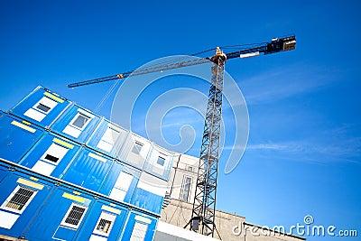 Lifting crane on building
