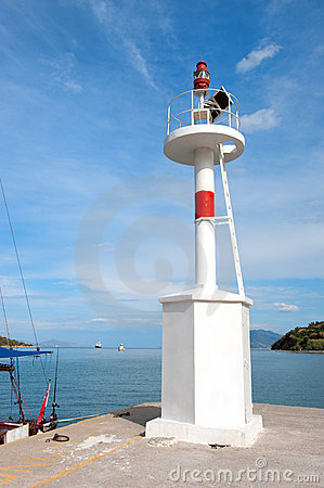 Light beacon at Greek harbor