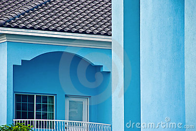 Light blue building with balcony