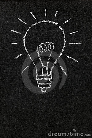 Light bulb on a blackboard with copy space