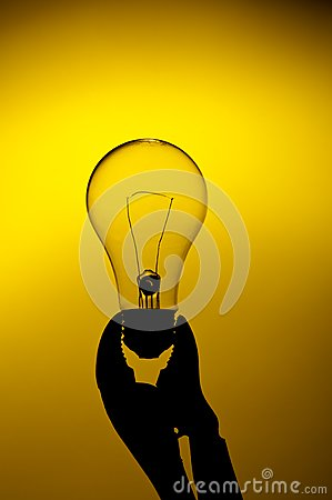 A light bulb held in a grip on a yellow gl