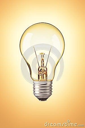 Light bulb on orange background