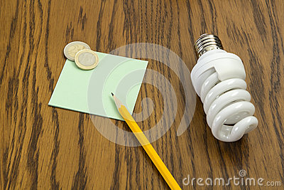 Light bulb with pencil and post-it