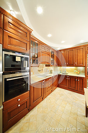 Free Light Clean Kitchen With Wooden Furniture Royalty Free Stock Images - 34550609