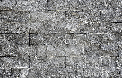Light coloured tiled granite wall