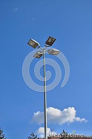 Light pole with blue sky background