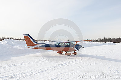Light private aircraft on taxi track