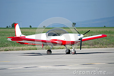Light red/white painted private aircraft