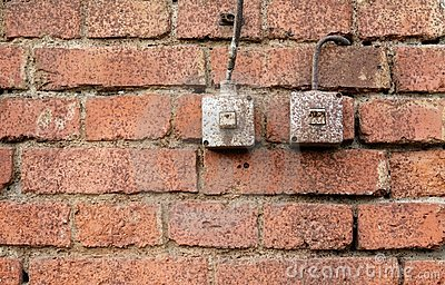 Light switches on brick wall