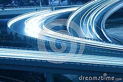 Light trails on grade separation bridge