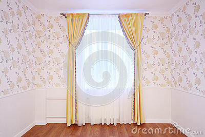 Light window with curtains in cozy and simple room