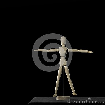 Light wooden doll on desktop