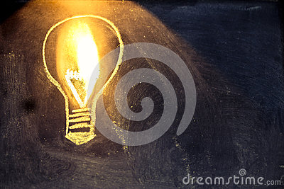 Lightbulb sketch on blackboard with light