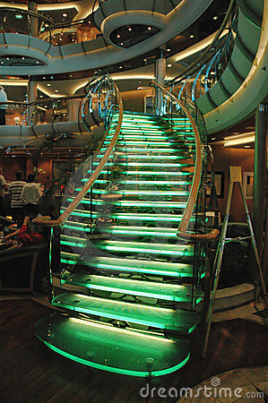 Lighted glass staircase in a cruise ship atrium