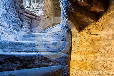 Lighted stone staircase in a medieval castle