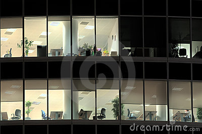 Lighted windows of deserted office at night