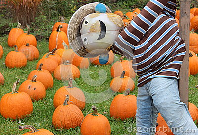 Lighthearted scarecrow at the pumpkin patch