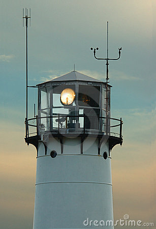 Lighthouse with beacon shining