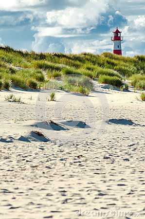 Free Lighthouse Behind Beach And Dunes Stock Image - 34056061