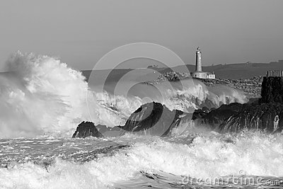 Lighthouse in the big waves, storm in Mouro, Santander