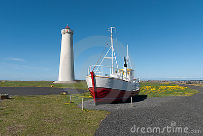 Lighthouse and boat in Iceland