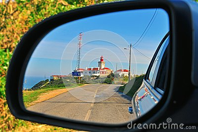 Lighthouse in the car mirror