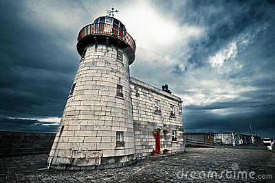 Lighthouse with cloudy and blue sky