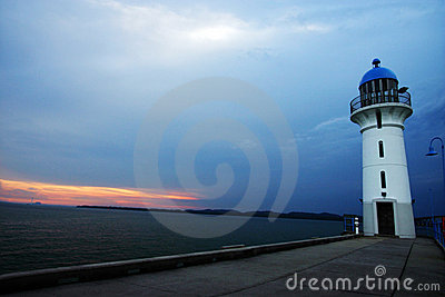 Lighthouse at evening sunset