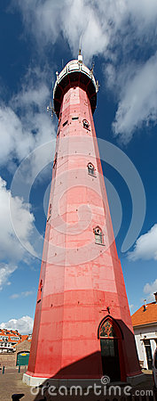 Lighthouse in Holland on the seashore