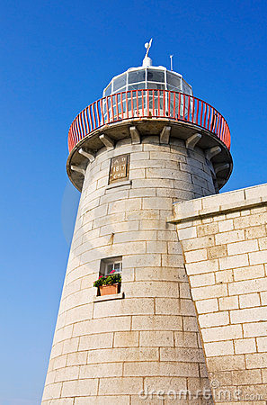 Lighthouse at Howth harbor in Dublin, Ireland