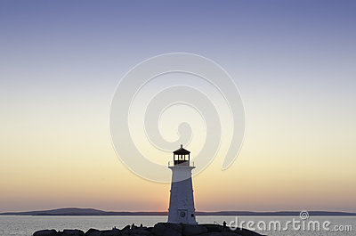 Lighthouse at Peggy s Cove, Nova Scotia at sunset