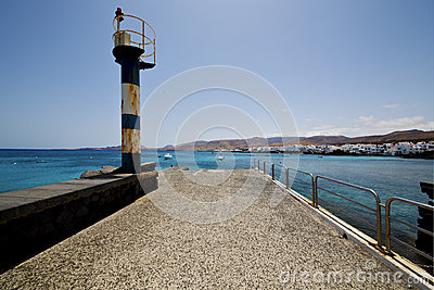 Lighthouse and pier boat in the blue sky   arrecife teguise