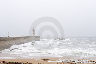 Lighthouse and pier in fog