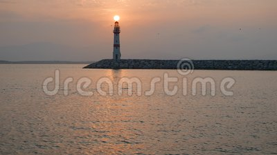 Lighthouse and rising sun above. 4k stock footage
