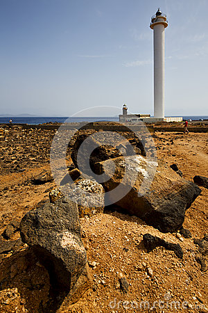 Lighthouse and rock in the blue sky   anzarote spain
