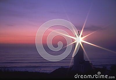 Pacific Coast Lighthouse shining Sunset Sunstar