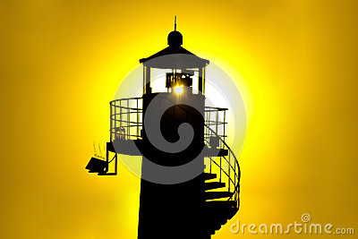 Lighthouse silhouetteat yellow sunset