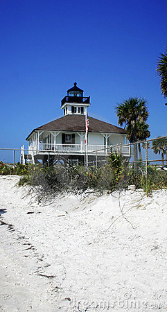 Lighthouse and white sand