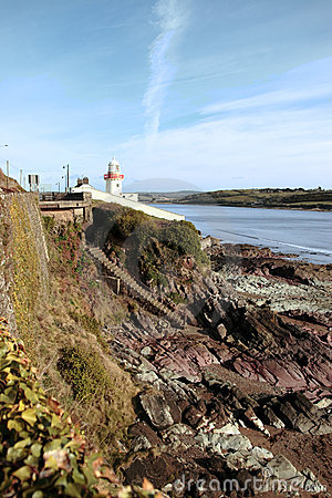 Free Lighthouse With Stairs To Rocky Beach Stock Photo - 15622520