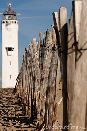 Lighthouse and wooden fence