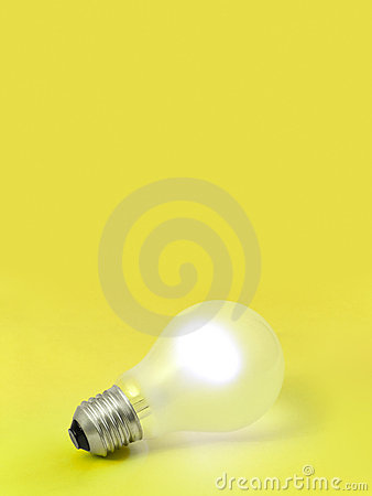 Lighting bulb on yellow background